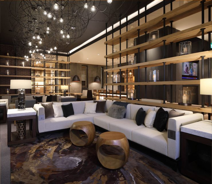 Artfully-designed lobby lounge with library, TV, and ample seating