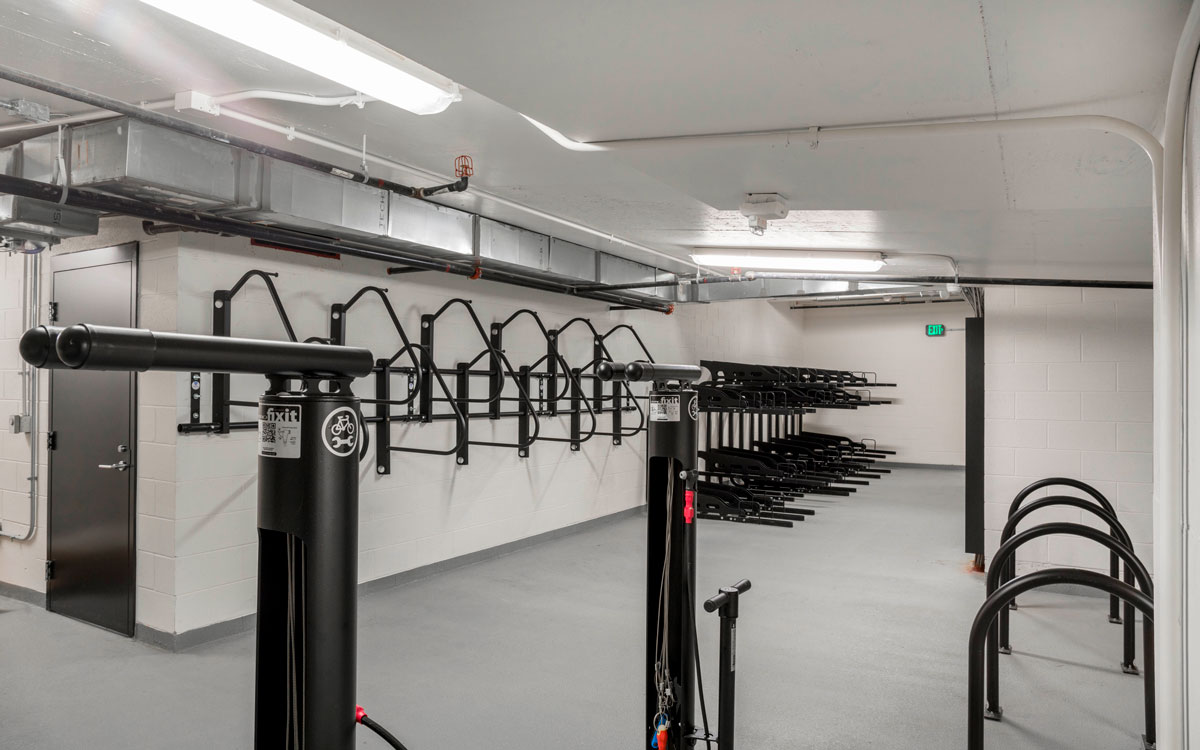 Bike storage space with rack on the wall in The Belgard residences