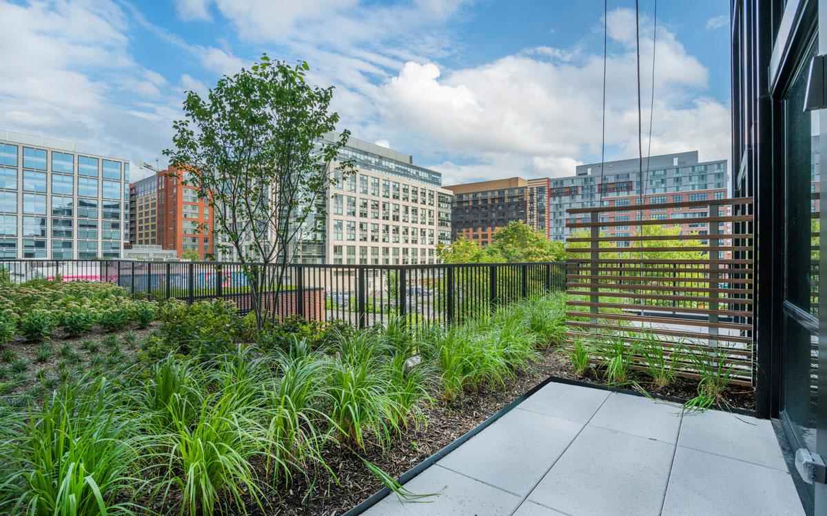 A patio with a garden at The Belgard