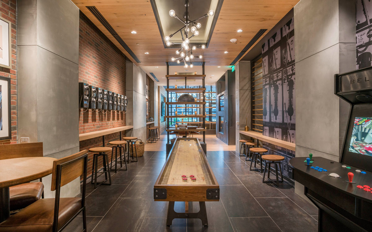 Belgard game room lobby with a shuffleboard and classic arcade games