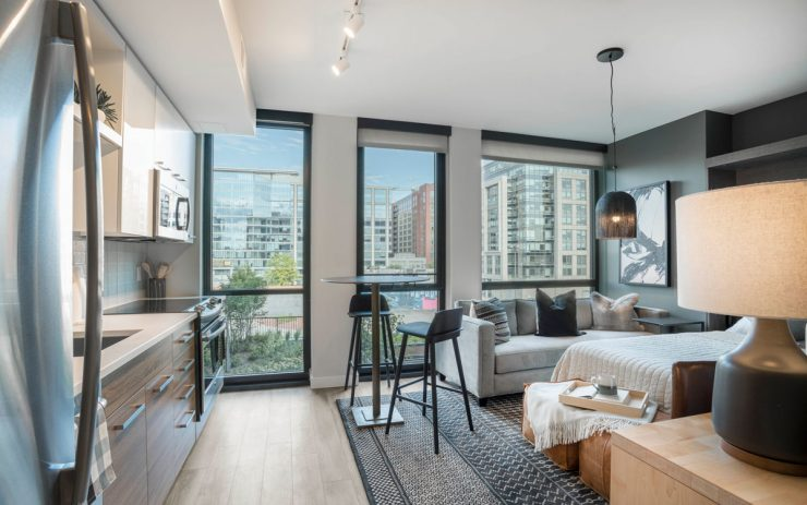 A well lit micro apartment at The Belgard with floor to ceiling windows in the NoMa neighborhood