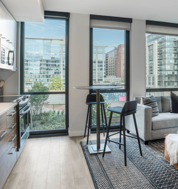 Micro apartment kitchen and living space at The Belgard