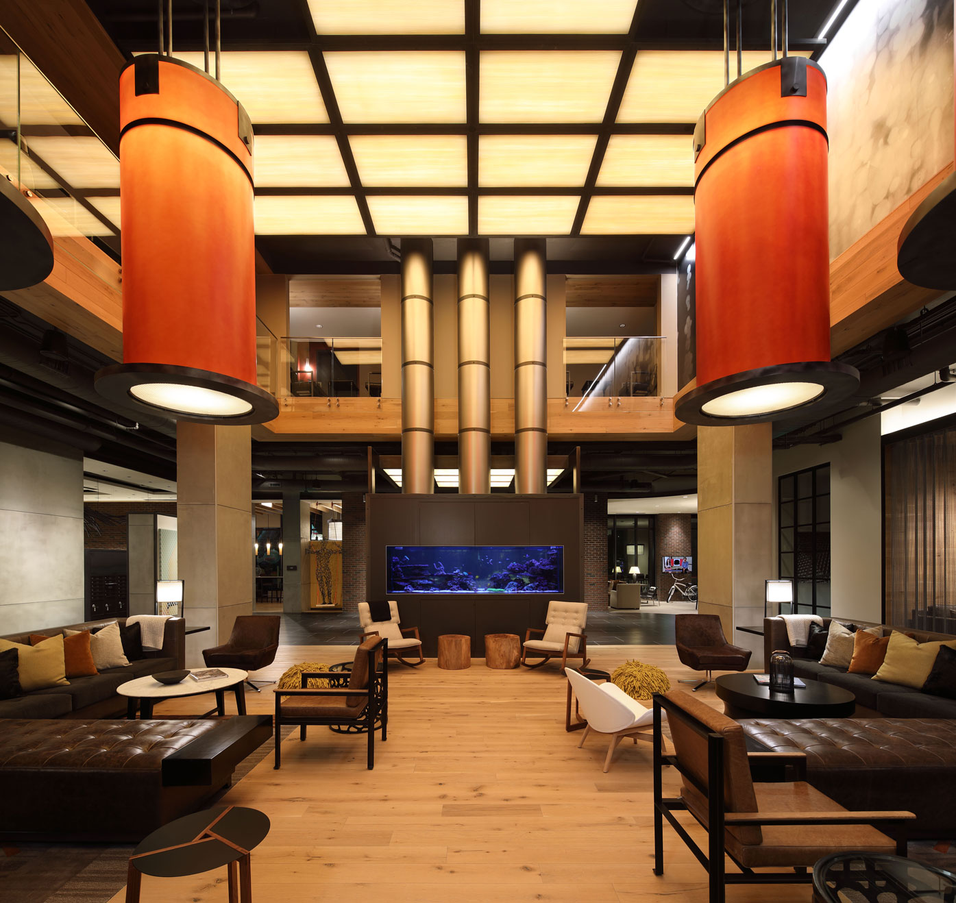 Sleek modern lobby with library, tv, and ample seating at The Belgard in NoMa washington DC
