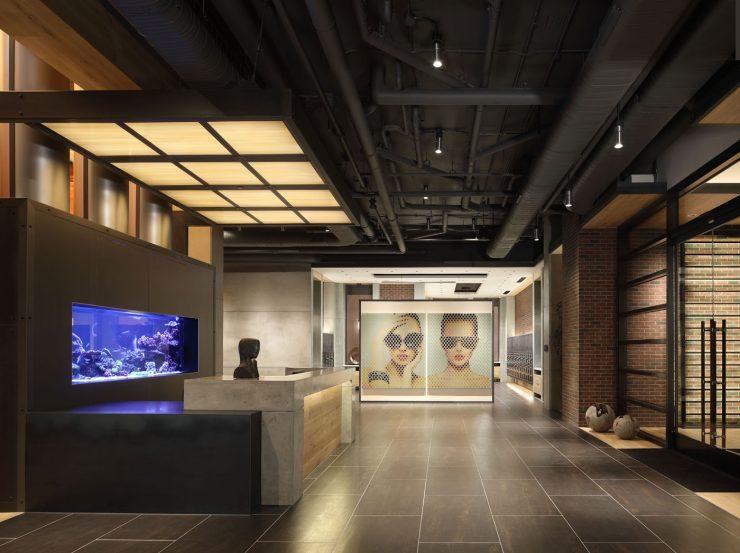 Sleek modern lobby at The Belgard featuring an aquarium and mailroom