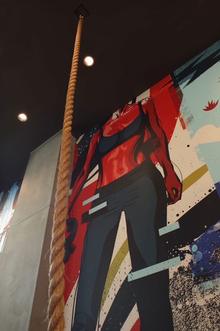 Fitness mural inside the state-of-the-art gym with a rope climb at The Belgard apartments