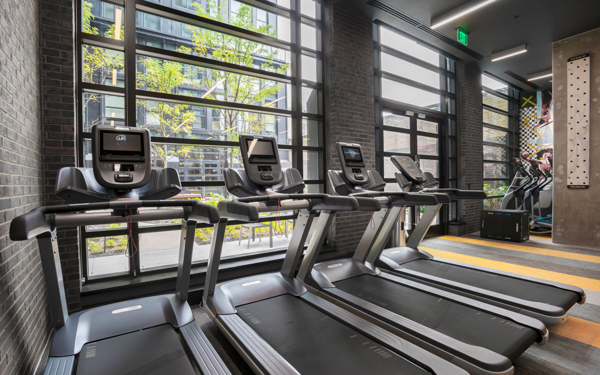 Four treadmills in The Belgard's state of the art fitness center