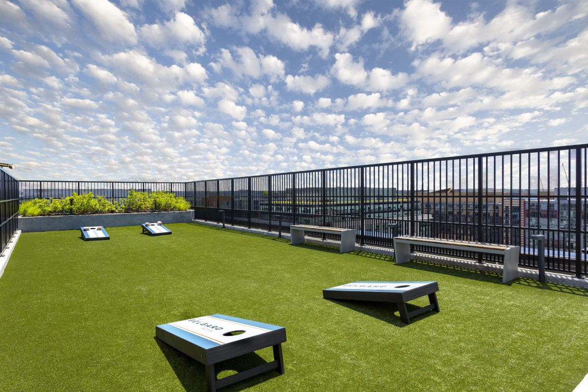 Cornhole on the roof at the Belgard NoMa